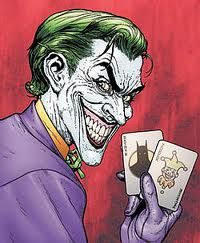 The joker holding playing cards