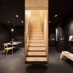 Box-like staircase forms a centrepiece  inside Bazar Noir concept store