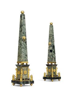 A PAIR OF ITALIAN ORMOLU AND VERDE MARBLE OBELISKS, 19TH CENTURY, IN THE MANNER OF FRANCESCO RIGHETTI. Each mounted with a lion mask and ring, on a plinth with corner grifin monopediae - Dim: 22 1/4 in. (56.5 cm.) high; 5 in. (12.5 cm.) square.