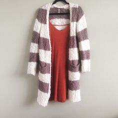 !Free people striped sweater A long buttoned free people sweater. Worn but still in great condition. Pairs well with dresses and skirts. Meant to fit oversized. Free People Sweaters