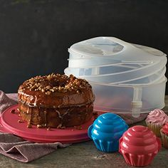 Bake your cake and take it, too! Includes Collapsible Cake Taker and set of two Cupcake Keepers. Collapsible Cake Taker can be adjusted from cm to cm Holds cakes and pies up to an cm diameter Dishwasher safe Limited Lifetime Warranty Tupperware Consultant, Take The Cake, Mixing Bowls, Cupcakes, Round Cakes, Panna Cotta, Baking, Desserts, Recipes