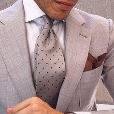 Concrete blazer, white dress shirt, concrete satin pindot necktie, brown kerchief, tanned face