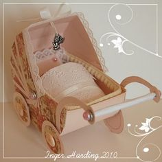 An old fashioned pram for a Baby Girl.  3D paper crafts made by Inger Harding
