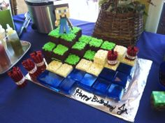 red twizzlers with longer black in middle, rice crispy treats, blue jello jigglers, brownies with green frosting.