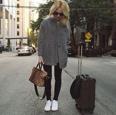 Your low-top sneakers will get you where you need to be going in no time at all, and distressed skinnies and a simple coat make for the perfect foundation. The best part about this look? All these pieces are wardrobe staples you'll surely want to wear while you're on your trip.