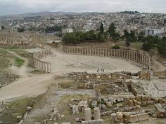 Jerash, Jordan. These are the remains of an ancient Greek city. The stones seem relatively undisturbed. When I went to visit, there were no other people there. I walked down roads among building that have existed for hundreds of years.