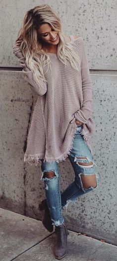 Soft pink top over blue jeans.