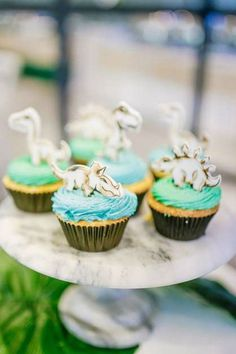 Take a look at this amazing dinosaur-themed birthday party! The cupcakes are so cute! See more party ideas and share yours at CatchMyParty.com #catchmyparty #partyideas #dinosaurs #dinosaurparty #boybirthdayparty #cupcakes