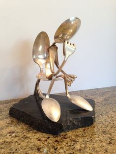 "Silverware art ""The Stinker"". Just one of those fun things I have to do for a Christmas gift for someone who has everything."