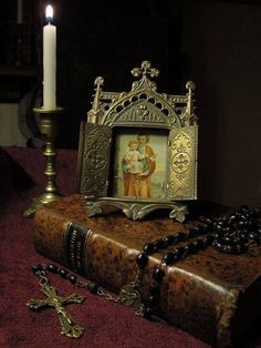 This is a beautiful image of a Bible, rosary, candle, and image of Saint Joseph with Jesus as a child. The link takes you to a Catholic Tumblr blog.