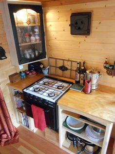 dickinson propane 2 burner stove tiny house | Other Side of Kitchen with Corner Cabinet and Mini Refrigerator