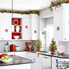 Christmas kitchen decorations - love the garland up top with the red