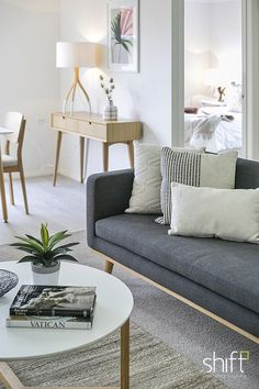open plan living, compact unit, white coffee table, neutral sofa, scatter cushions, console table, table lamp