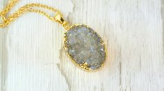 Unique necklace with the oval-shaped pendant, made of natural druzy that sparkles in the sun, gold-plated on edges. Long-lasting, anti tarnish plating.