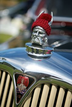 Tiny #knit hat yarn bombing on a car.  This is one of the coolest yarn bombings I've ever seen!