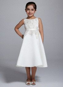 This satin tank tea length dress is super cute and ideal for your flower girl on your special day!  Tank bodice features dazzling gold embellishments that are sure to catch light in photos.  Satin band adorns the waist.  Fully lined. Back zip. Imported polyester. Dry clean only.