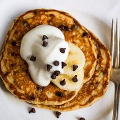 Banana-Chocolate Chip Pancakes  This healthy whole-grain buttermilk pancake recipe adds mini-chocolate chips and mashed banana to the 100% whole-wheat flour base