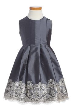 Free shipping and returns on Isabel Garreton Sleeveless Taffeta Dress (Toddler Girls) at Nordstrom.com. Sequined floral patterns shimmer and sparkle at the hemline of a sleeveless taffeta dress with crisp, cascading pleats. Each heirloom-quality piece is handmade by a skilled artisan in Chile, preserving traditional art forms and empowering women to improve their lives and support their families.