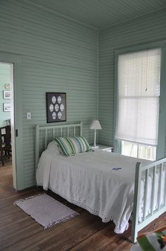 cozy little bedroom - love! the color of the walls!