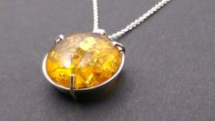 Sterling silver and amber pendant by Steven Corfield Design.
