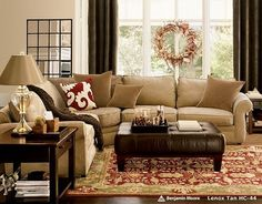 browns, black, cranberry, olive green, tan and cream - the essential color palate for a cozy family room