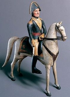 Maker unknown, George Washington on Horseback, early 19th century, carved and painted wood, leather, and brass. Collection of Shelburne Museum.
