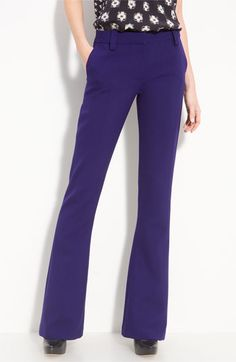 These flares are amazing.  The hue is a vibrant deep purple and they are a stretchy cotton blend fabric that is form fitting and super comfy.