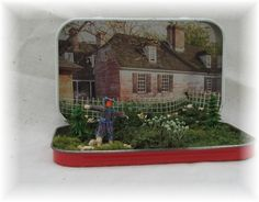 Another type of diorama/miniature, made with an Altoids tin -- I like the idea of the lid being the backdrop.