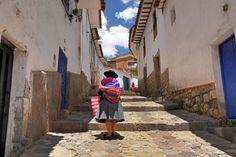 Quechua woman climbs the narrow streets of Cusco in the colorful San Blas neighborhood