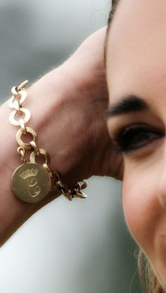 Kate' s charm bracelet featuring her monogram - reportedly an early wedding present from Camilla, who owns a very similar piece. The disc charm has Kate's monogram on one side and Camilla's on the other. Both are Cs under a coronet, but Kate's C has an extra curl, while Camilla's is surrounded by a circle.