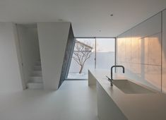 Ginan House by Keitaro Muto Architects - kitchen to the outside