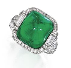 PLATINUM, EMERALD AND DIAMOND RING.  Centered by a sugarloaf cabochon emerald weighing approximately 10.65 carats, accented by numerous round, baguette and epaulet-shaped diamonds weighing approximately 2.05 carats