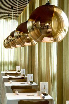 Copper Shades hang in a row at Forneria San Paolo in Brazil.   Architect: Studio MK27 Photography: Rômulo Fialdini