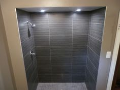 I love this shower tile and lights. -