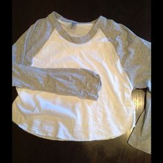 American Apparel heather grey crop raglan! NWOT Great sexy style, hits above belly. 3/4 sleeves. Plain is $19, printed is $2550/50 cotton poly American Apparel Tops