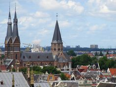 """panorama Amsterdam, Posthoornkerk (Haarlemmerstraat), a neo-gothic church by architect P.J.H. Cuypers, 1860 - a view from the clock tower of the """"Beurs van Berlage"""", Damrak / Beursplein, Amsterdam (1903)"""