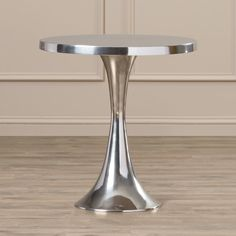 Add a mod and polished touch to your home decorations with this end table, pairing a round silhouette and shimmering silver finish for a super chic and functional design.