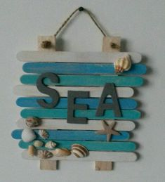 Beachy naambord van ijsstokjes @ SEA by natasha The post Beachy naambord van ijsstokjes @ SEA by natasha appeared first on Easy Crafts. Sea Crafts, Diy Home Crafts, Wood Crafts, Crafts For Kids, Crafts With Seashells, Seashell Crafts Kids, Resin Crafts, Baby Crafts, Popsicle Stick Art