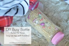 Heading on a long trip? Here are some must haves when traveling with toddlers +a DIY Busy Bottle to occupy them in the car!