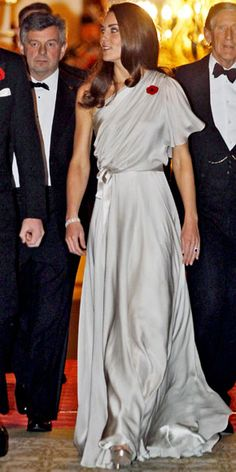 Catherine Middleton  WHAT SHE WORE  Middleton hosted a charity dinner in a draped Jenny Packham gown and silver platforms