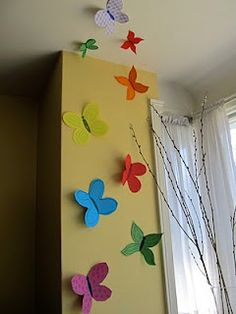 We were inspired by the Made Blog and made these construction paper butterflies last year.