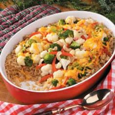 Brown Rice Vegetable Casserole Recipe -One taste of this crowd-pleasing casserole brings compliments and requests for my recipe. It's been in my file for as long as I can remember. The blend of tender vegetables and rice is perfect for holiday meals and dish-to-pass affairs.
