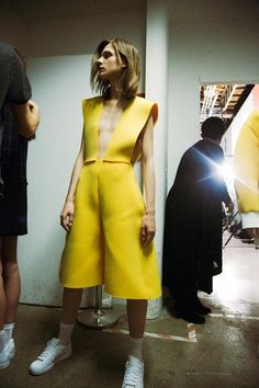 Canary yellow neoprene worn with Adidas Superstars at Jacquemus AW14 MFW. More images here: http://www.dazeddigital.com/fashion/article/19025/1/jacquemus-aw14