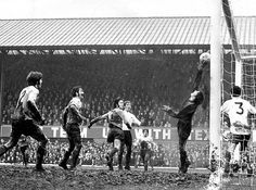 9th January 1971. Derby County goalkeeper Colin Boulton pushes Wolves' Jimmy McCalliog's header over the bar on a truly awful Baseball Ground pitch.