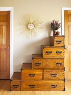 This unique wooden dresser resembles stacked boxes or suitcases. Each level provides a cute spot to place decor, such as the pretty purple plant on top. Dresser Alternative, Tiny House Stairs, Loft Stairs, Bedroom Dressers, Chest Dresser, Bedroom Doors, Dresser As Nightstand, Bedroom Photos, Staircase Design
