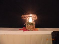 used canning jars, split peas, corn and an orange tea light with a bow tied of cording...Using these on my window sills on my screened in porch...very fallish!!!