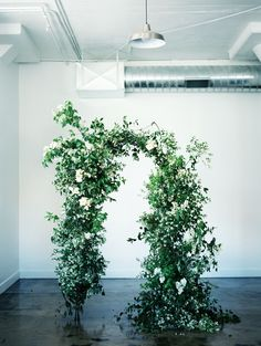 Bring Spring indoors with a wild and lush arch. Utilizing the fresh greens in this industrial space is very un Wedding Ceremony Flowers, Wedding Ceremony Decorations, Ceremony Backdrop, Wedding Flower Arrangements, Wedding Decor, Wedding Plants, Wedding Arches, Cheap Wedding Flowers, Floral Wedding