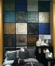 Faux tin panels spray painted in coordinating colors for an accent wall or art piece.