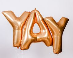 Gold Foil Letter Balloon With Mystery Tassel by StudioMucci
