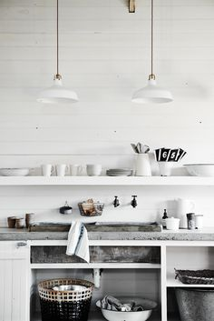 <p>Inspired by scandinavian interiors, this beautiful old original 1902 barn at The Estate Trentham is painted white with rustic concrete floors, detailed wood walls and a concrete bench top sink and